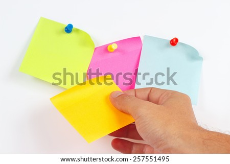 Hand sticker sticks on a white message board - stock photo