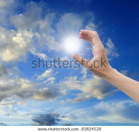hand sun and blue sky with copyspace - stock photo