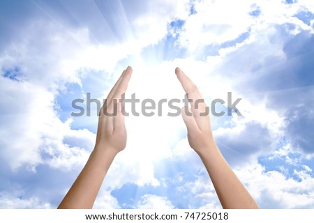 hand sun and clouds with copyspace showing freedom or solar power concept - stock photo