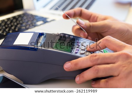 Hand Swiping Credit Card In Store : Selective Focus - stock photo