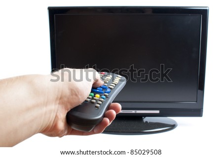 Hand switching channel in modern television  set, on white background