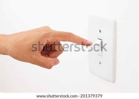 hand switching light power switch on or off. - stock photo