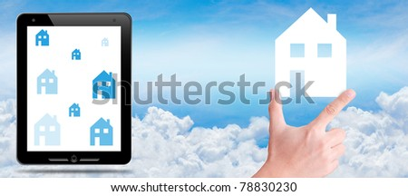 hand take house icon on the sky - stock photo