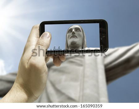 Hand takes a picture of the Christ in Rio de Janeiro, Brazil - South America  - stock photo