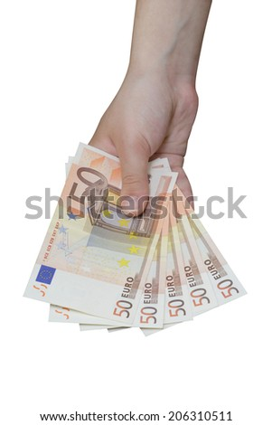 Hand taking a pile of euro banknotes - stock photo