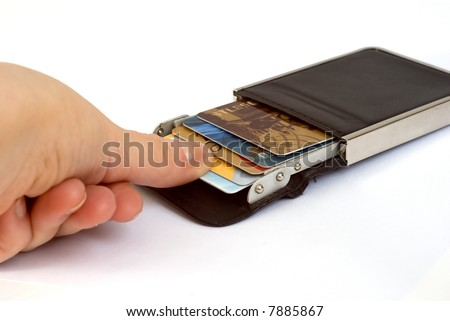 Hand taking out a credit card