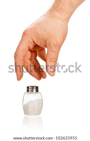 Hand taking salt cellar isolated on white background