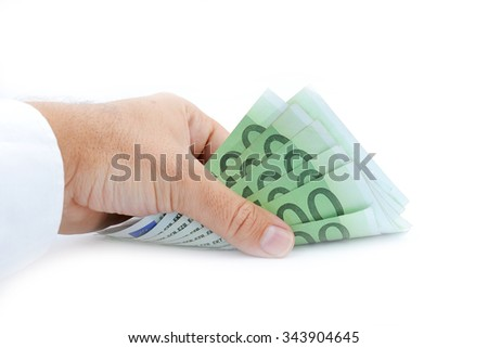 hand taking up 100 euro banknotes isolated on white
