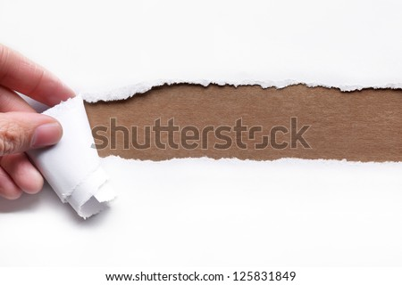 Hand tear a strip of paper,copy space for your text. - stock photo