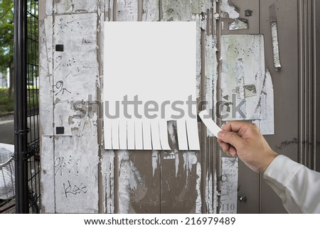 hand tear paper from empty advertising with street - stock photo