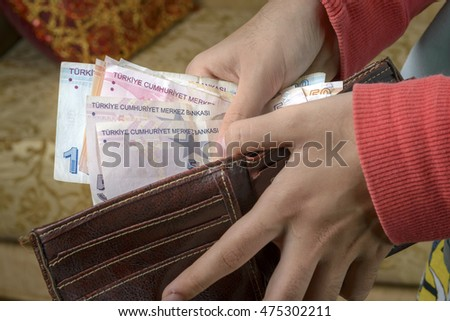 hand that pays taking the turkish money from wallet