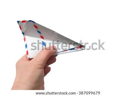 Hand throwing  a paper plane (made of Post envelope). Isolated on a white background.  - stock photo