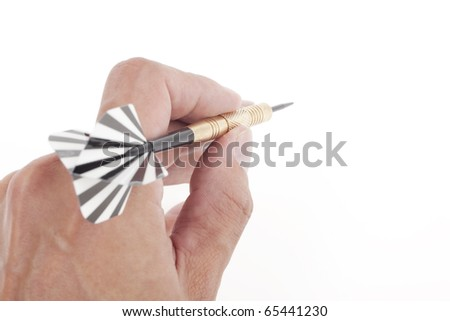 hand throwing dart to target - stock photo