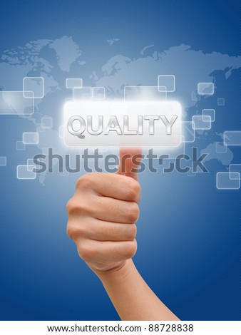 Hand thumb up onm quality button - stock photo