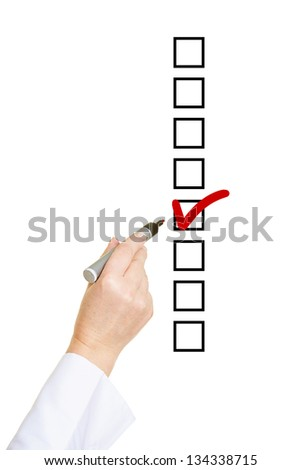 Hand ticking checkbox on To-Do list with red checkmark - stock photo