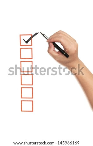 Hand ticking on check box using a pen - stock photo