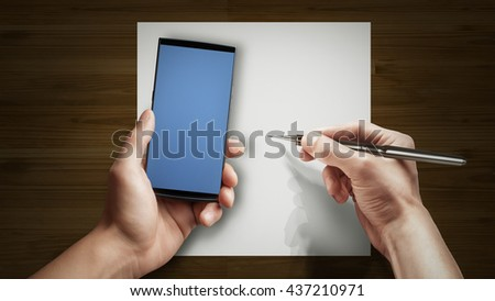 Hand to hold mobile phone isolated on gray background. High resolution - stock photo