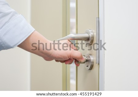 Hand to opening/close door knob - stock photo