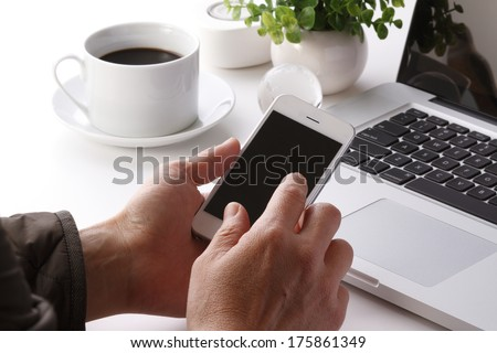 Hand to use a smartphone - stock photo