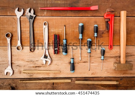 Hand tool complete set the Wrench, screwdriver, Phillips screwdriver, flat crowbar,brass hammer,pipe wrench,punch,Hex wrench on wood background. - stock photo