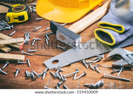 Hand tools and nails on a wooden table