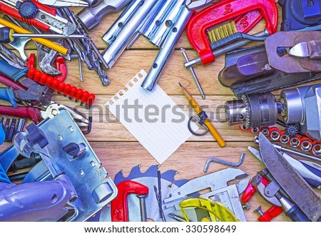 Hand tools lying wooden background - stock photo