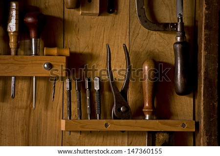 Hand tools placed neatly in their racks in the woodworking shop at Kline Creek Farm, West Chicago, IL. - stock photo