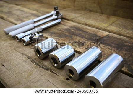 Hand tools set on wooden background. - stock photo