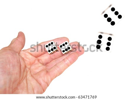 hand tossing pair of dice , white background