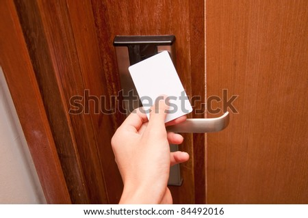 hand touch keycard on hotel door
