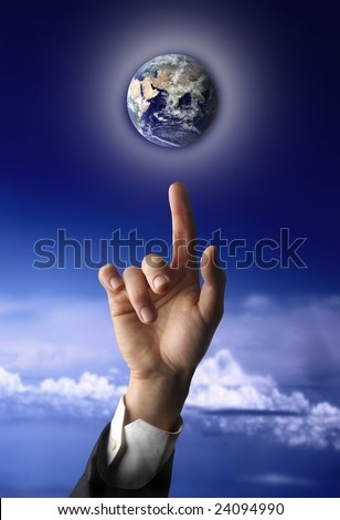 hand touch planet earth - stock photo
