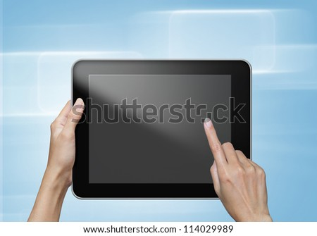 hand touch screen on tablet pc. blue background - stock photo