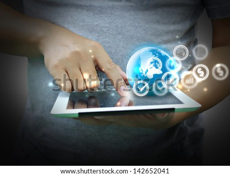 hand Touch Screen tablet with business Icons - stock photo