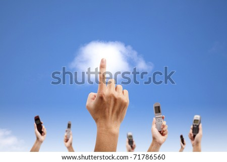 Hand touch the cloud and holding mobile phone. cloud computing and smart phone concept - stock photo