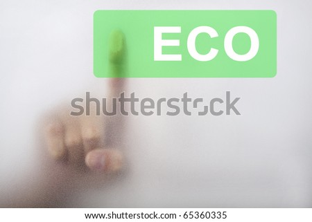 Hand touch the eco button - stock photo