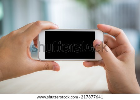 Hand touch the Screen on the Smart Phone - stock photo
