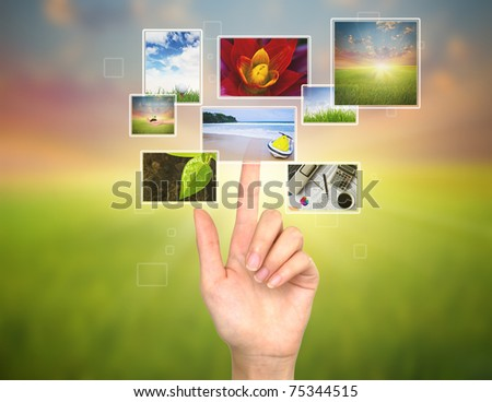 Hand touches the flow of images - stock photo