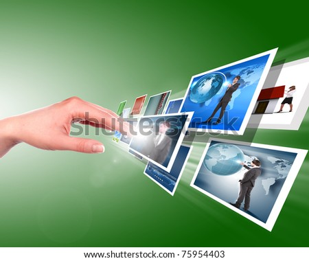 Hand touches the flow of images. Symbol of media streams - stock photo