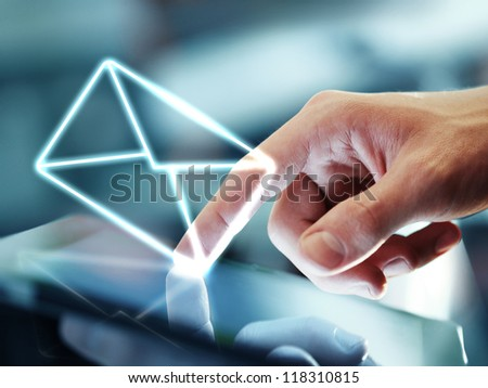 hand touching digital tablet and mail symbol
