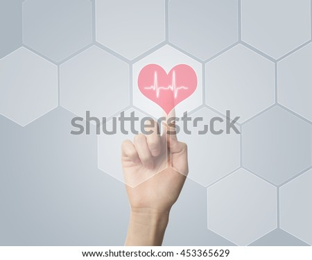 Hand touching E-Health symbol connected to health, medical and technology symbols - stock photo