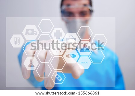 Hand touching first aid sign - abstract medical background - stock photo
