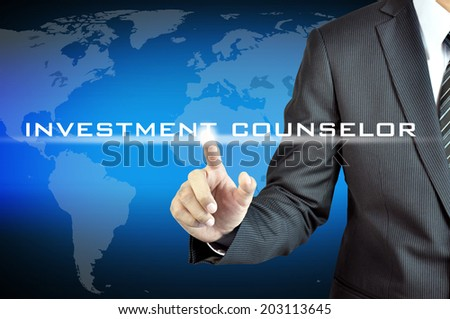 Hand touching INVESTMENT COUNSELOR words  on virtual screen - investment & financial planning concept - stock photo