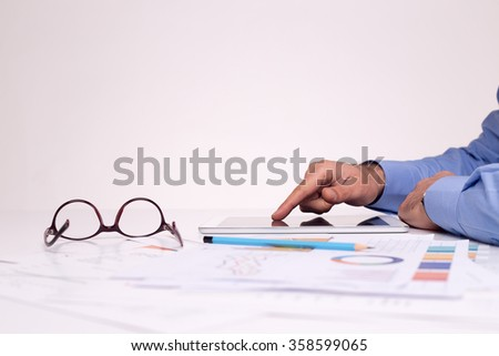 Hand touching on modern digital tablet pc at the workplace - stock photo
