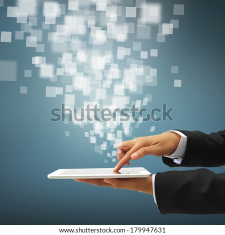 hand touching screen on modern digital tablet - stock photo