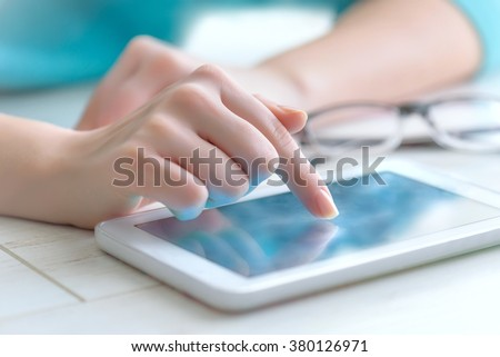 Hand touching screen on modern digital tablet pc. - stock photo