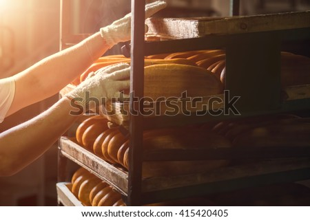 Hand Touching Shelves With Bread Shelves With Loaves Of Bread Another One Is Ready