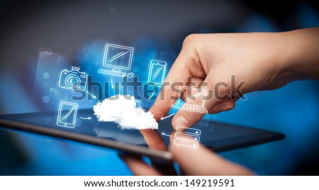 Hand touching tablet pc, mobile cloud concept - stock photo