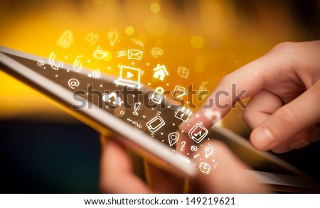 Hand touching tablet pc, social media concept - stock photo