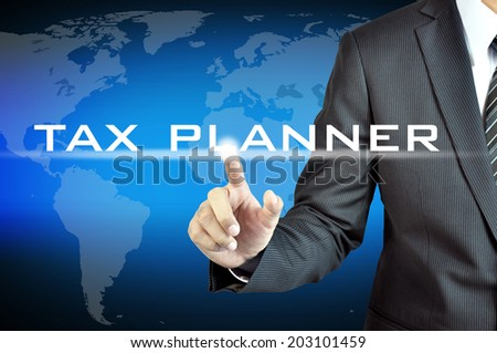 Hand touching TAX PLANNER words on virtual screen - business & financial planning concept - stock photo