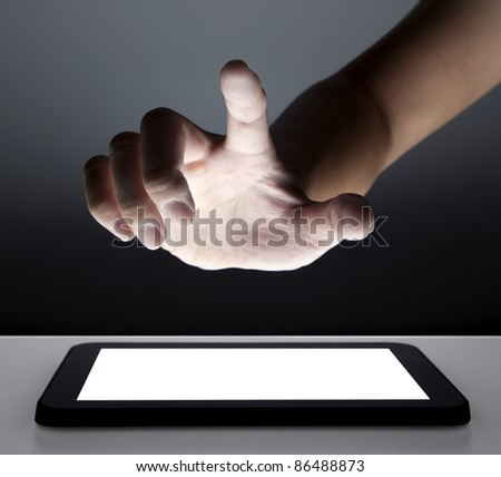 hand touching the touch screen of tablet pc - stock photo